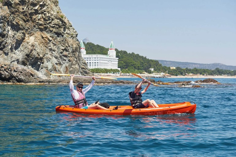 family in tandem kayak