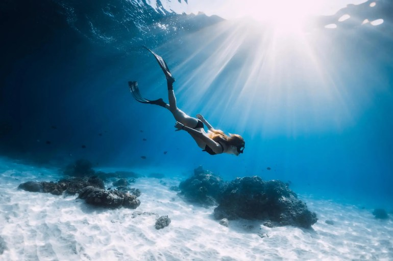 woman snorkeling in clear water