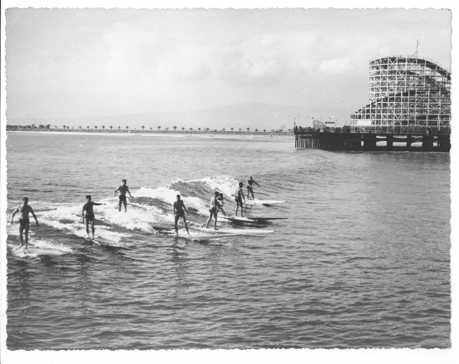 Before the breakwater was built, Long Beach was a popular place to surf in the 1930s. Photo: Lind Family Collection