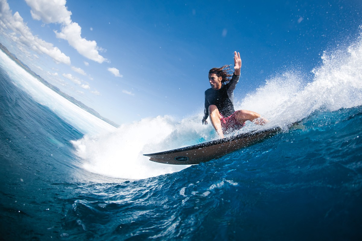 """One of the opening pages of each issue of SURFER is titled """"Mindsurf"""", which features a surfer riding a wave that can and will induce the most intense form of mind-surfing. For our Fall 2019 issue, we chose to run this images of Ryan Burch, slicing up a runner at Cloudbreak on one of his pickle-forked nosed handshapes. You're mindsurfing this wave right now, aren't you?"""