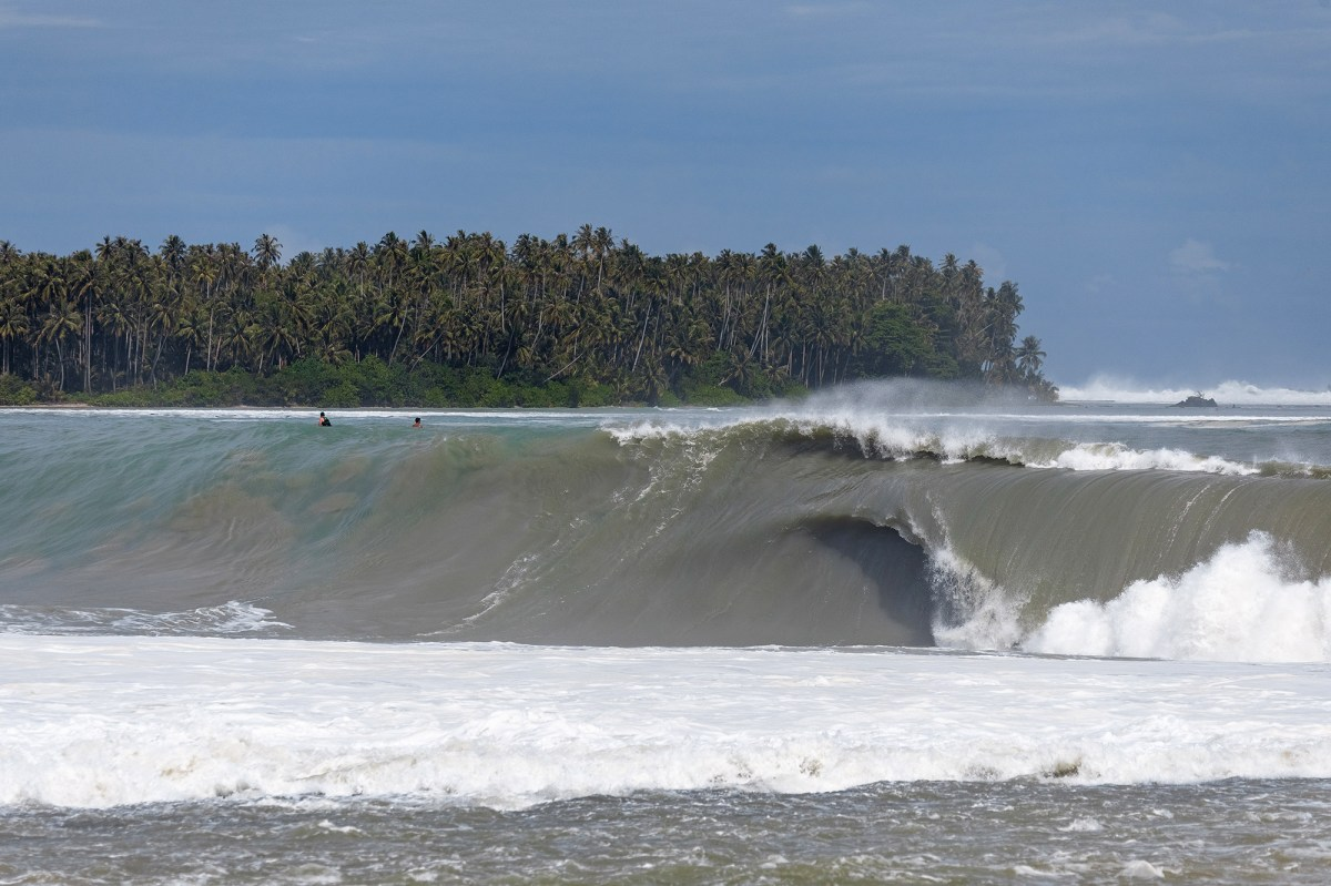 NiasLagundri Bay in Nias is by most accounts a point break, but morphs into a slab-like wave when the swell grows in size. This swell, back in the summer of 2018, marked my first visit to Nias. I had seen numerous photos of other large swells but it wasn't until I was swimming out there that I came to understand how much it mimicked the characteristics of other slabs. The water sucking off the reef physically pulls you further out to sea, and as the wave throws over, a quarter of it becomes a thick lip. Common characteristics of slab waves are that the waves often grow in lip thickness and not so much in height. This was very evident on the biggest day of the swell. The wave heights weren't significantly taller than the first few days but the swell energy focused so heavily on the outside bowl that many waves were simply un-rideable – they were too doubled up and too fast to catch on many of the sets.