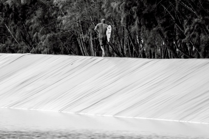 Slater first to ride his manmade wave in board shorts | Surf Park Central
