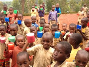 Children receiving nutritious drink so that they might have enough energy for success in school.