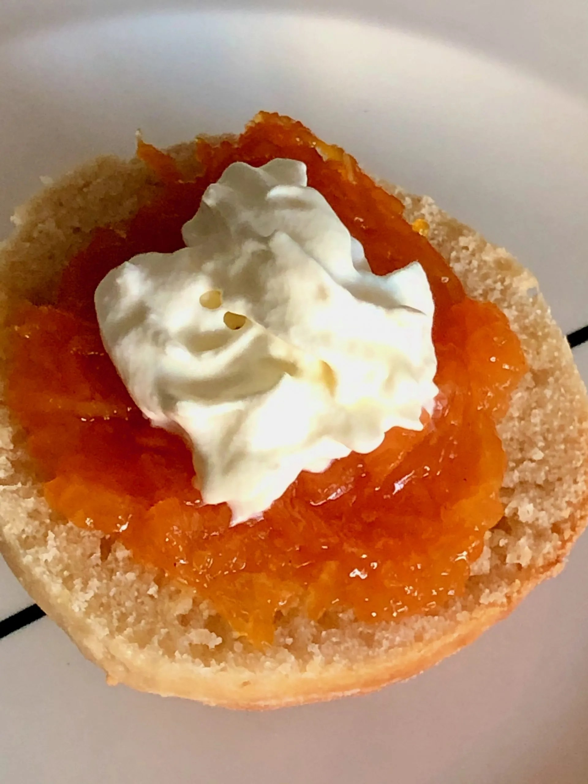 carrot jam with citrus on a scone with cream