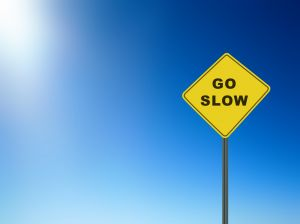road sign saying 'go slow' from a post at Holy in the Daily