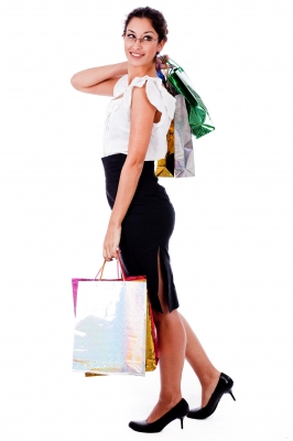 Young woman holding shipping bags for What to Wear to the Next Prophetic Prayer Gathering post