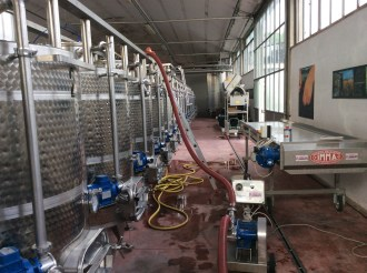 pumping the juice into the vat
