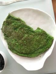 half-eaten wild garlic pancake, look at that brilliant color! So good.
