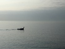 A fisherman heads out early in the morning.