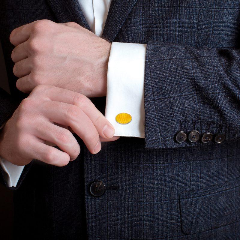 Yellow enamel cufflinks on silver