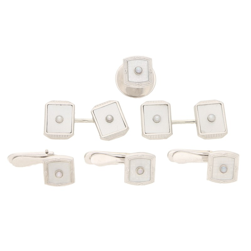 A set of mother-of-pearl cufflinks and dress studs