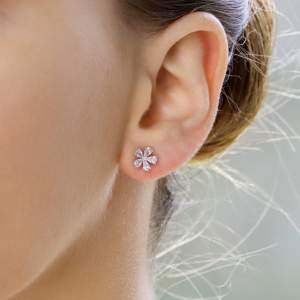Diamond flower cluster earrings set in 18K white gold