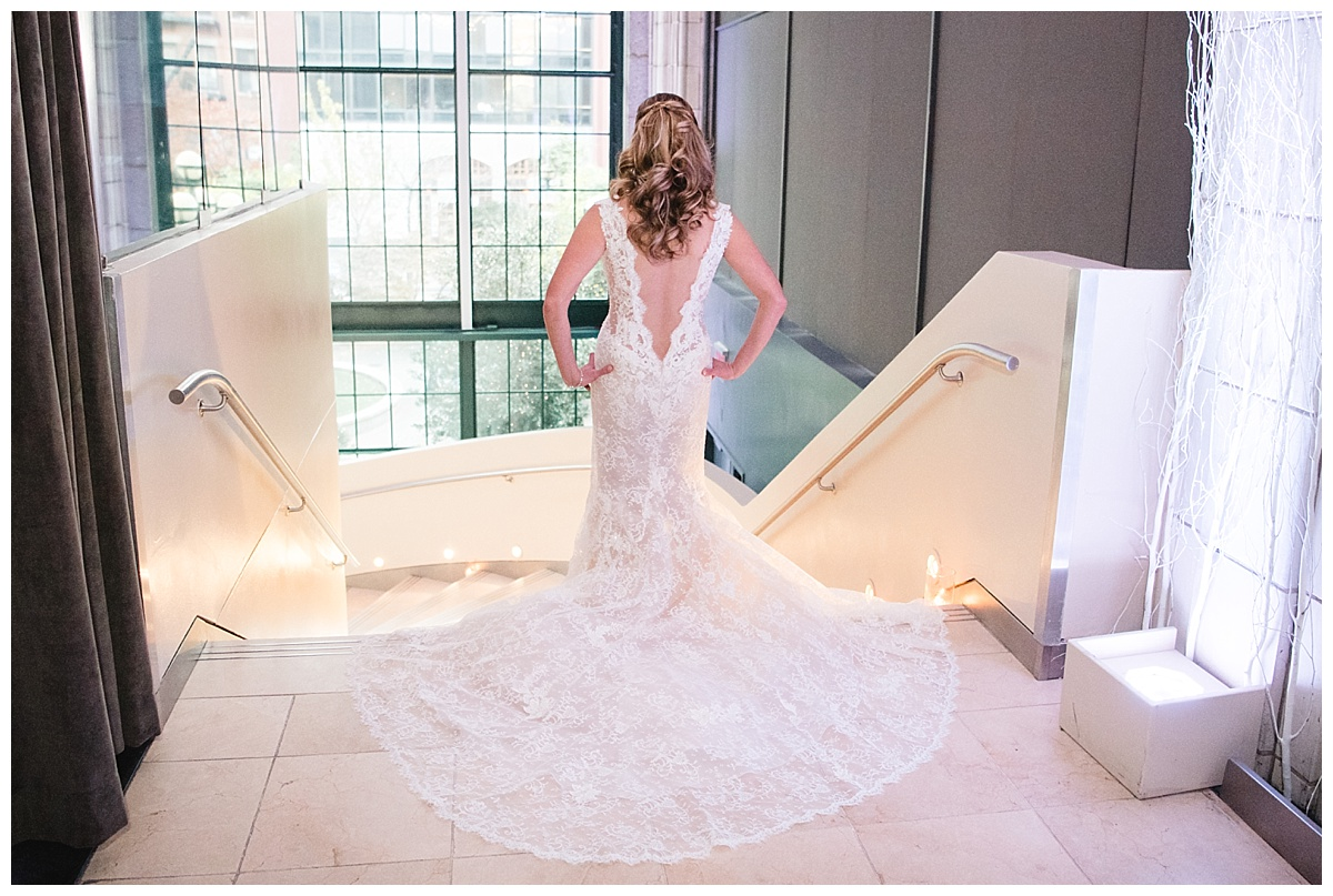 A back of a bride with her wedding dress on a wedding day at Guastavinos in New York City. Dress by Ines Di Santo.