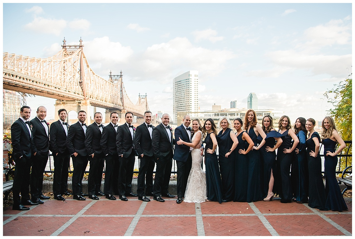 A portrait session of a bride and a groom along with their wedding parties on a wedding day at Guastavinos in New York City. Dress by Ines Di Santo.