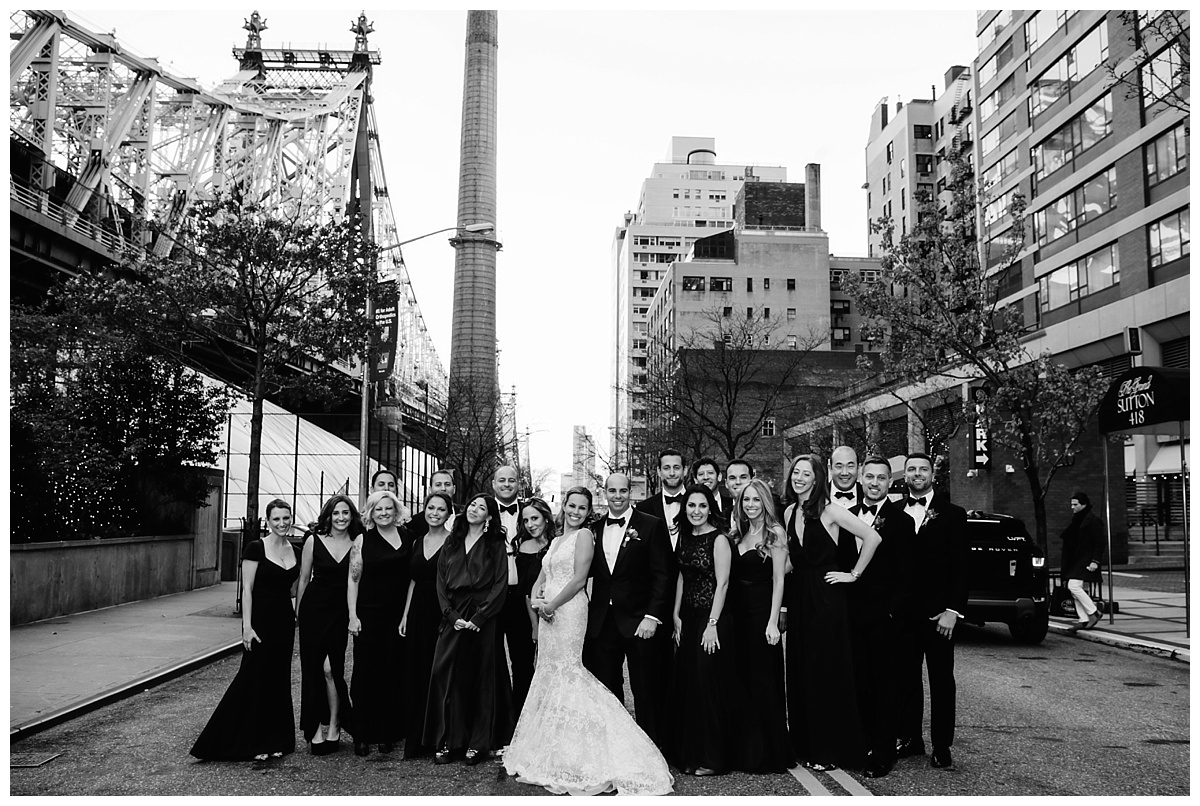 A portrait session of a groom and a bride with their wedding parties on a wedding day at Guastavinos in New York City. Dress by Ines Di Santo.