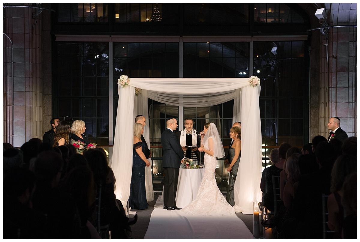 A jewish wedding ceremony at Guastavinos in New York City. Dress by Ines Di Santo.