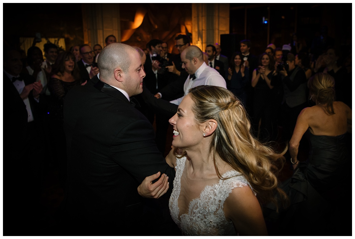 A bride and wedding guests dancing during a wedding reception at Guastavinos in New York City.