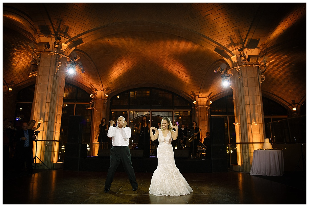 A bride dancing with her father during a wedding reception at Guastavinos in New York City. Dress by Ines Di Santo.