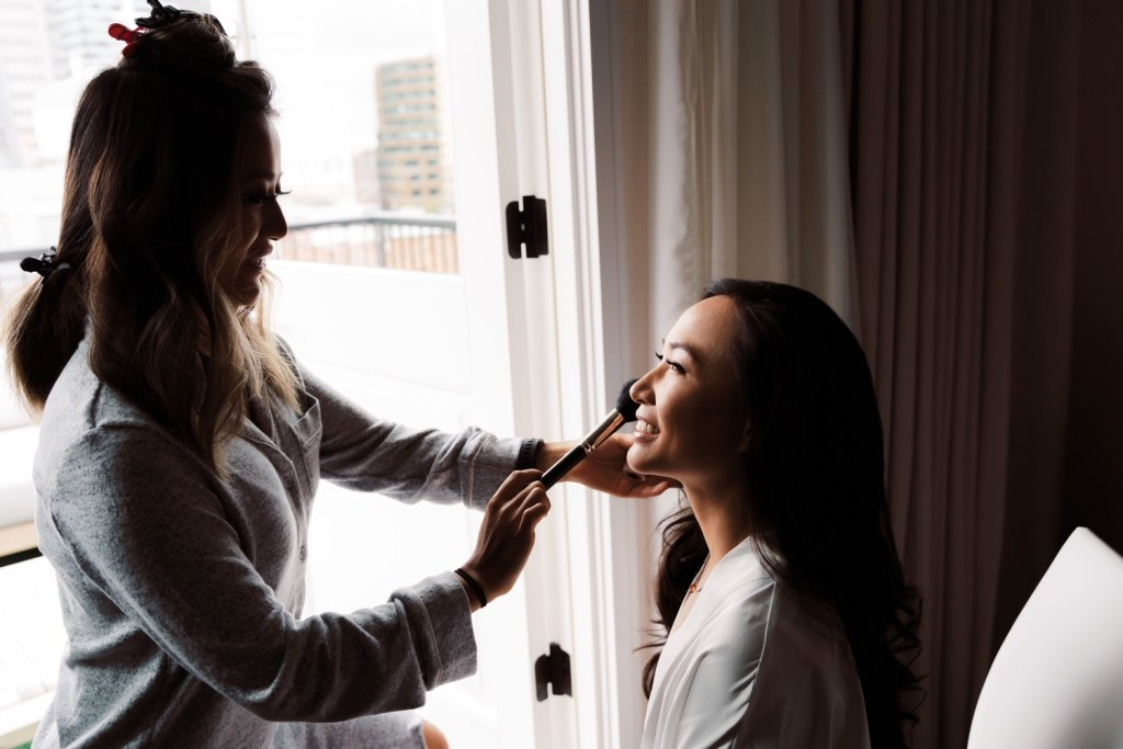 A bride getting ready in Mr. C Seaport Hotel.  for her wedding at Cipriani Wall Street.