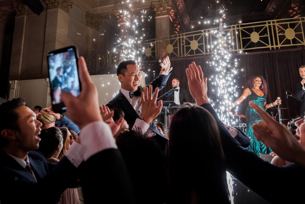 Wedding guests celebrating a newly wedded husband for his marriage at Cipriani Wall Street in New York City. Music by Hank Lane Band