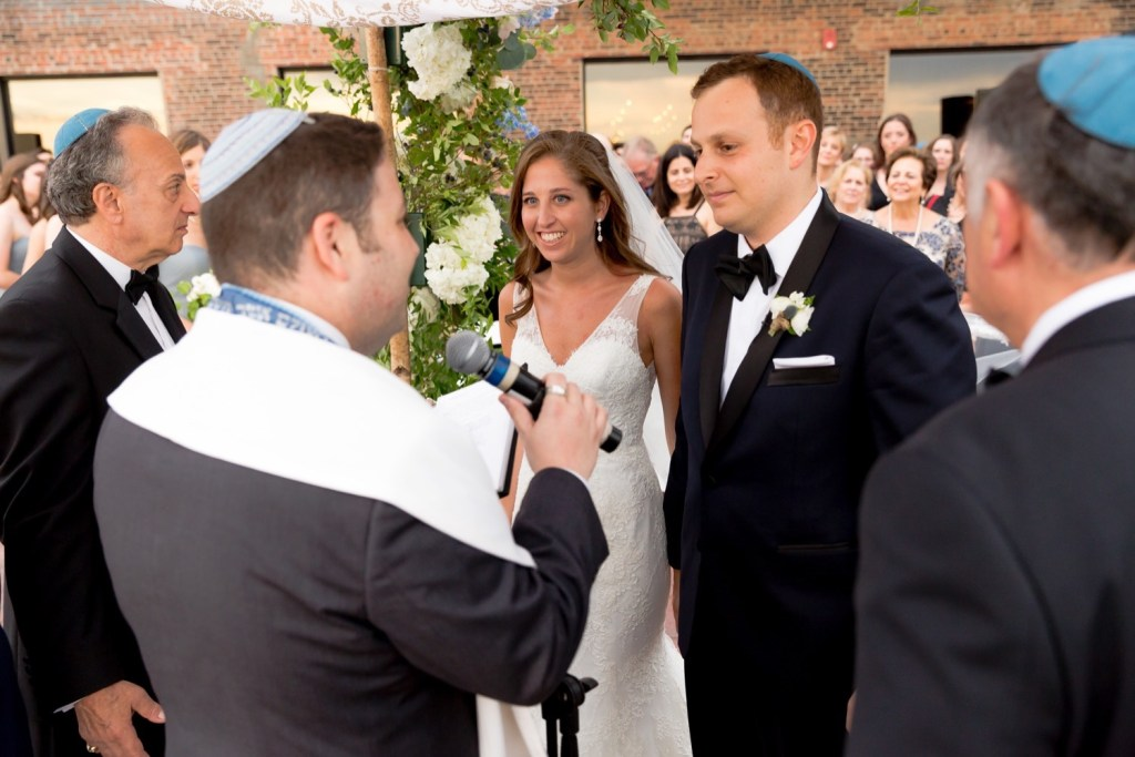 Officiant leading a wedding ceremony at Liberty Warehouse, Brooklyn New York.