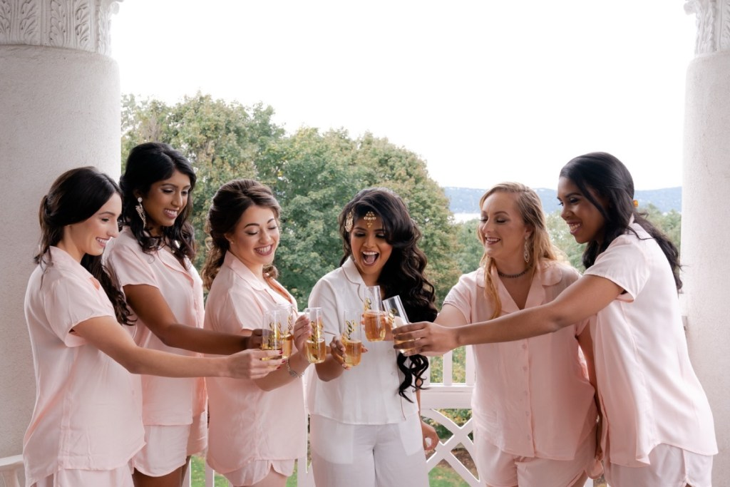 A bride and her bridesmaids celebrating the bride's wedding day at the Tappan Hill Mansion.