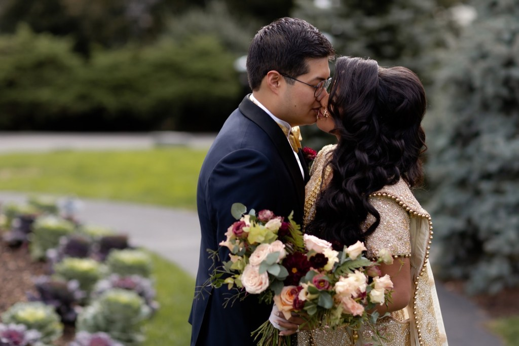 A groom kissing his bride during a first look on a wedding day at the Tappan Hill Mansion.