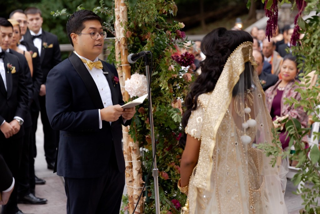 A groom is reading his vows for his wife during a wedding ceremony at the Tappan Hill Mansion.