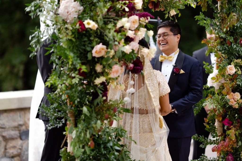 A groom burst out of laugh during a wedding ceremony at the Tappan Hill Mansion.