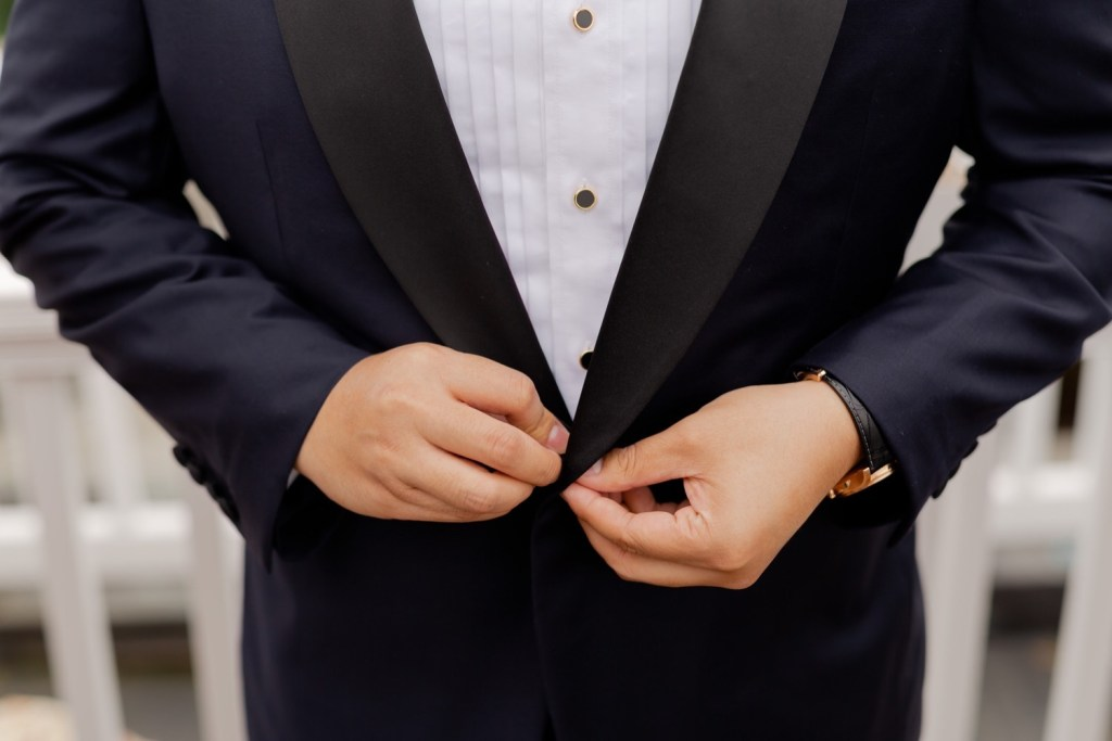A groom wearing his wedding jacket.