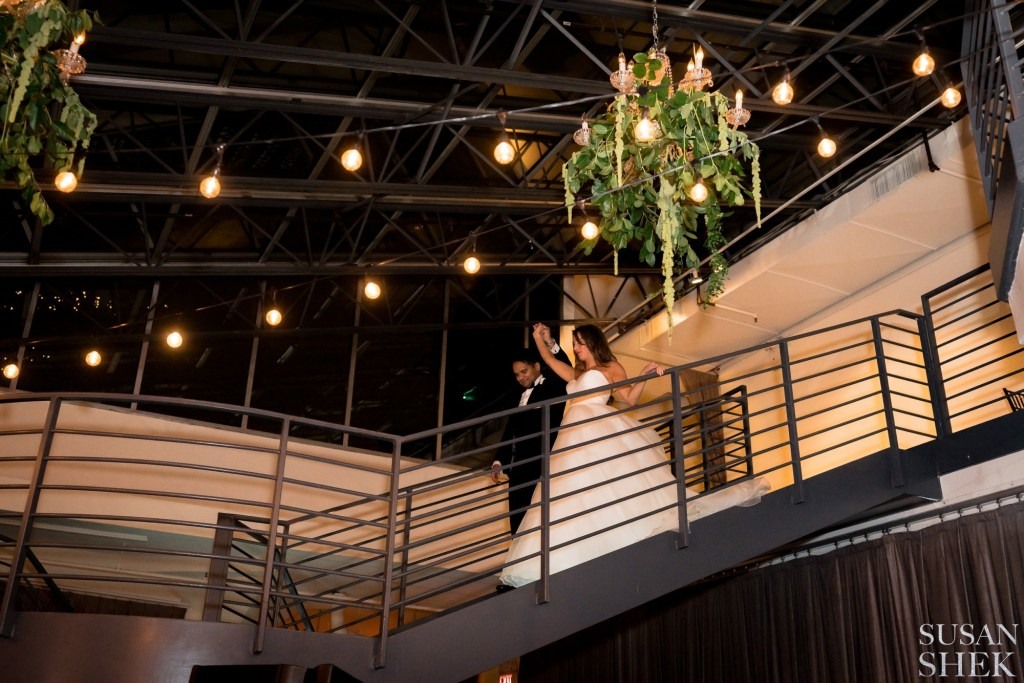Bride and Groom making a grand entrance during their wedding at tribeca rooftop