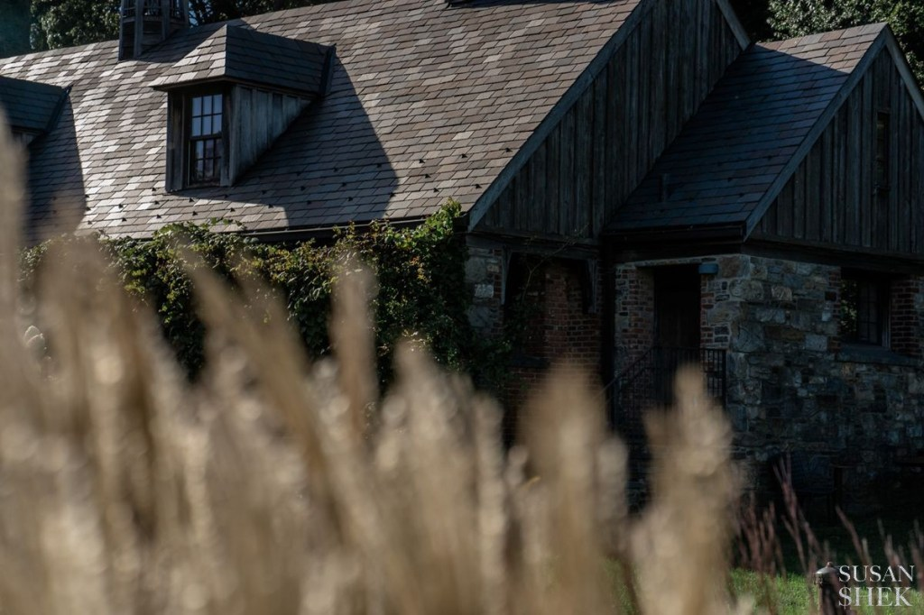 perspective through the grass at blue hill stone barns
