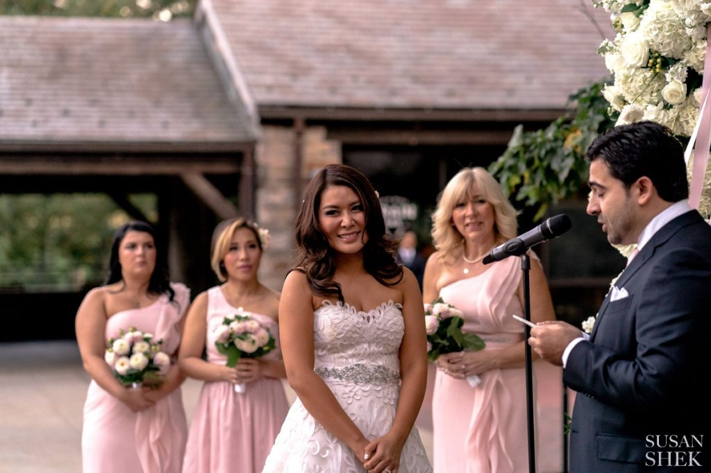 bride smiling at blue hill stone barns wedding ceremony