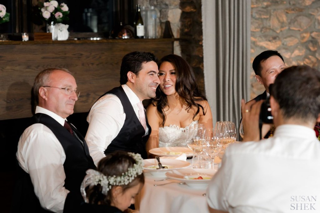 candid photo at the married couples table at blue hill stone barns