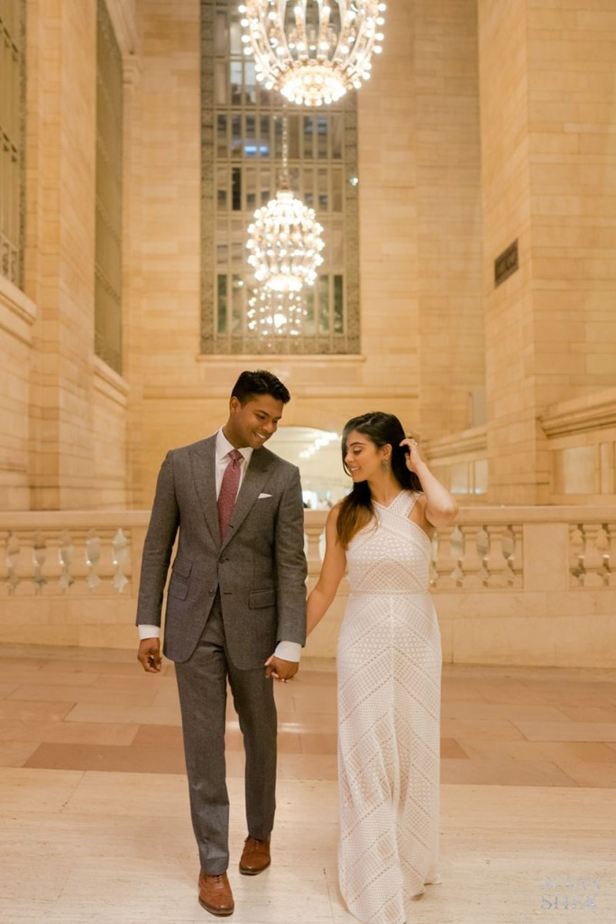 Walking with a couple in Grand Central in Vanderbilt Hall