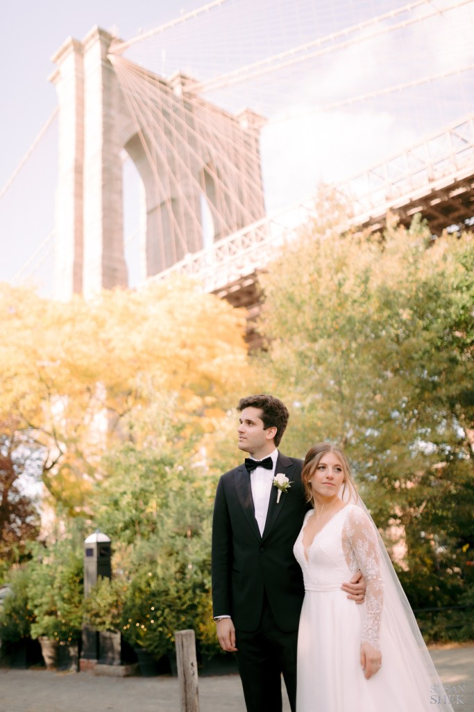 couple with brooklyn bridge in background