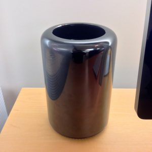 No, not a sleek vase from the Martha Stewart collection. It's the sleek new Mac Pro, made in the USA.
