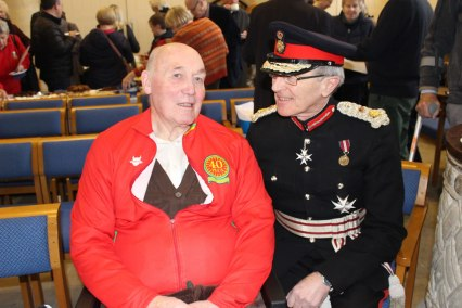 Allan Plumpton of St Mary's Goring being congratulated by the Lord Lieutenant after his amazing fundraising efforts