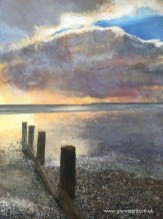 A painting in acrylics of a dramatic sunset at Bracklesham Bay