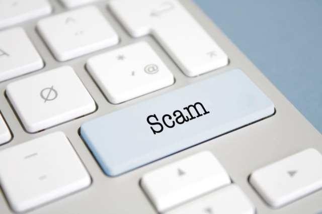 Scam, written on a keyboard