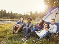 Group of young people camping
