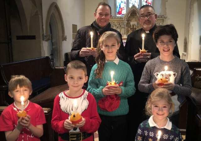 Nick Herbert and Father Peter with (back left to right) Abigale Rigby, Arran Sibbald, Harry Rigby, Sam Nelson and Margot Hall.