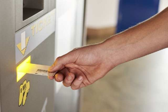 Close Up Of Man Paying For Car Parking At Machine