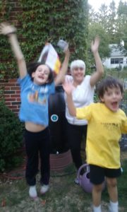 Volunteers jump for joy for our 2016 winners of the rain barrel and compost bin raffles.