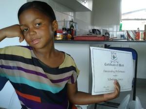 Ndindi with her certificate
