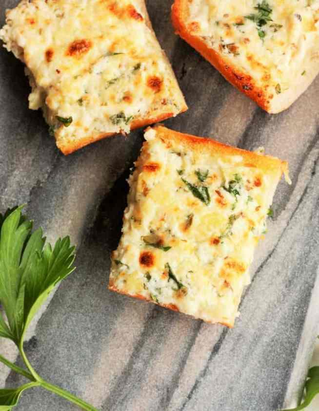 Three pieces of cheesy garlic bread