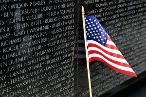 Vietnam Veterans Memorial and an American flag