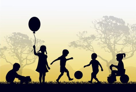 45045362 - silhouettes of children playing outside in the grass and trees