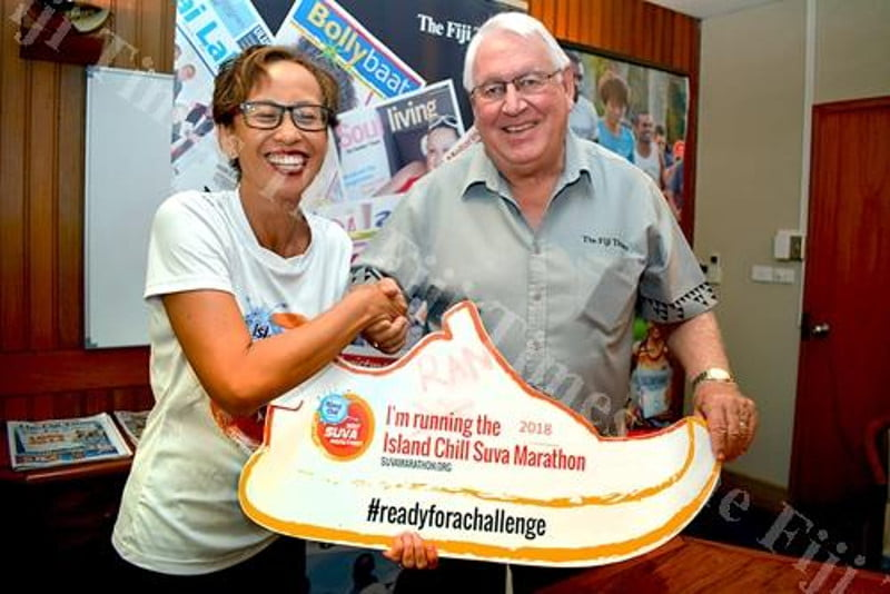 Gina Hound Lee (left) of the Suva Marathon Club shakes hands with The Fiji Times publisher Hank Arts after signing the Island Chill Suva Marathon sponsorship agreement yesterday. Picture: PAULINI RATULAILAI