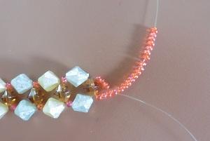 Armband met kralensluiting andere sluiting 15 kleine kralen aan 1 draad